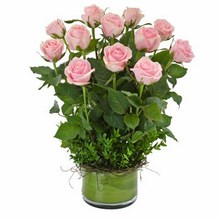 Arrangement of 12 Long Stemmed Pink Roses in a Low Glass Vase