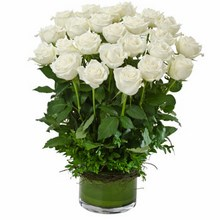 Arrangement of 24 Long Stemmed White Roses in a Low Glass Vase