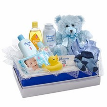 Teddy Bear with a Selection of Baby Care Goods