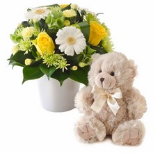 Bright mixed arrangement with a teddy bear