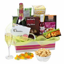Assortment of sweet gourmet treats topped off with a bottle of quality Australian sparkling wine