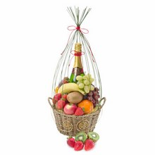 Seasonal fruit in a basket with a bottle of Australian bubbly